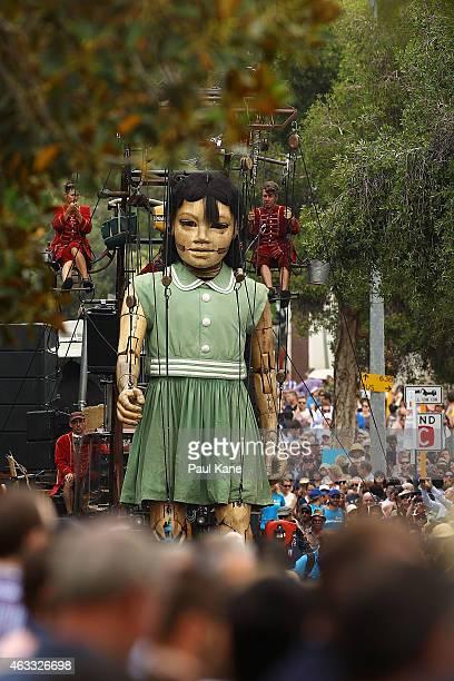 The little girl Giant walks down Hill Street during the Perth International Arts Festival on February 13 2015 in Perth Australia