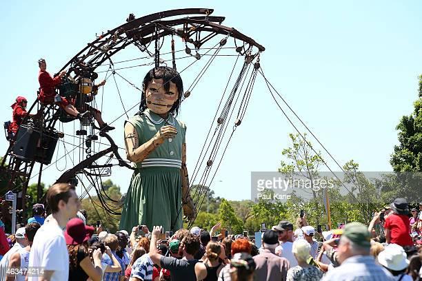The Little Girl Giant walks down Plain Street during the Perth International Arts Festival on February 15 2015 in Perth Australia