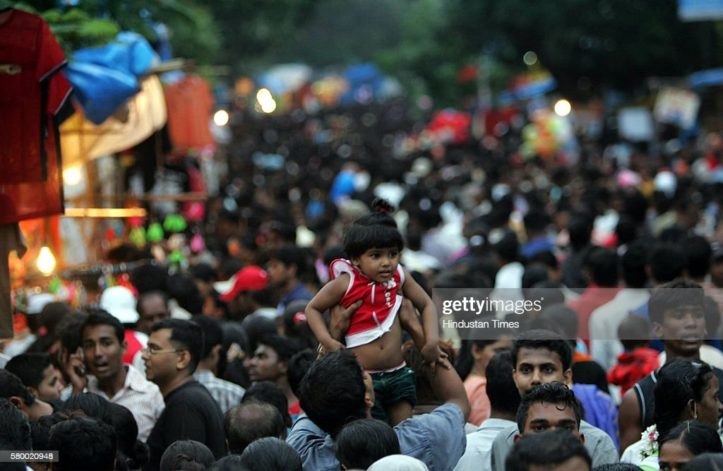 The little one is given a lift by her dad to get the best view to avoid getting suffocated On Sunday the last day of the Mount Mary Fair devotees...