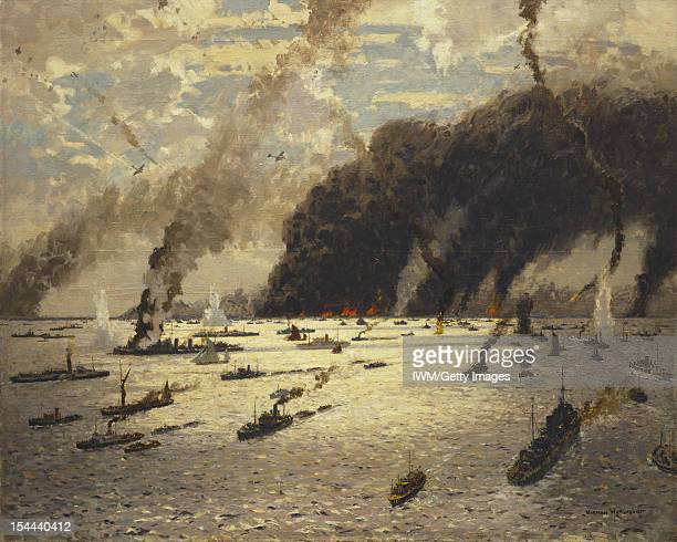 June 1940 A view over a sea filled with vessels of different sizes Fires burn on the horizon filling the sky with clouds ofthick grey smoke There are...