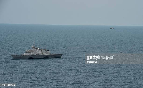 The littoral combat ship USS Fort Worth with its 11meter rigidhull inflatable boat trailing behind conducts visual and subsurface searches on January...