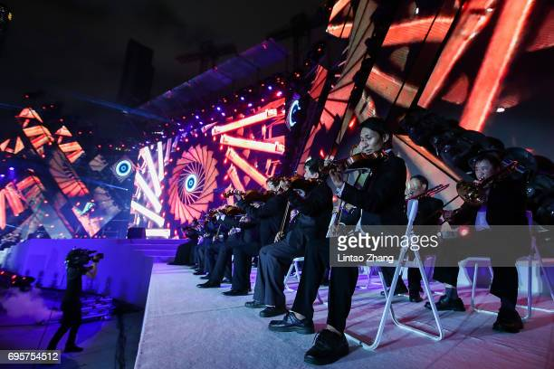 The Live Symphonic Orchestra plays on stage during the 'Transformers The Last Knight' China World Premiere and Ten Year Anniversary Celebration at...