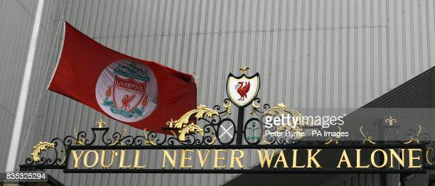 The Liverpool flag flies at halfmast outside the Shankly Gates next to the Hillsborough Memorial