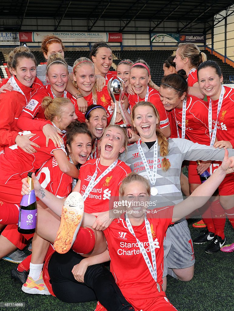 The Liverpool Ladies team celebrate with the WSL trophy after their victory during the FA WSL 1 match between Liverpool Ladies FC and Bristol Academy...