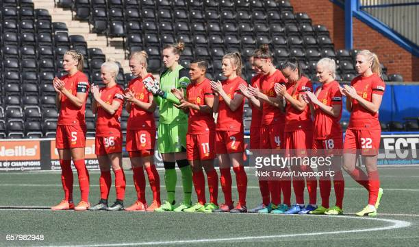The Liverpool Ladies team during the minute's applause in honour of Liverpool legend Ronnie Moran before the Liverpool Ladies v Notts County Ladies...