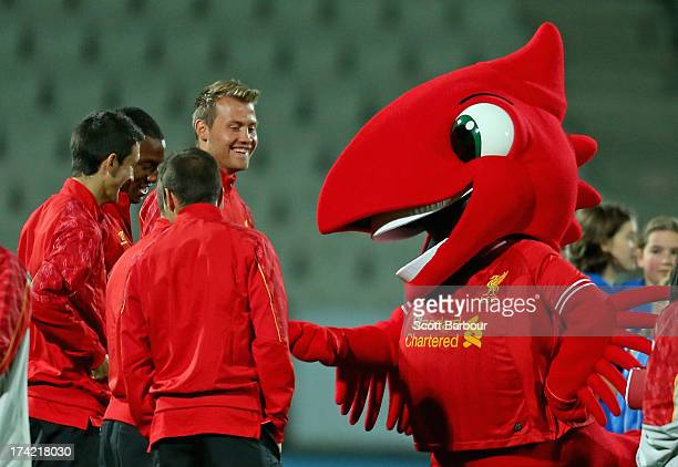 The Liverpool mascot 'Mighty Red' gestures towards Simon Mignolet Andre Wisdom Luis Alberto Iago Aspas and Jay Spearing of Liverpool during a...