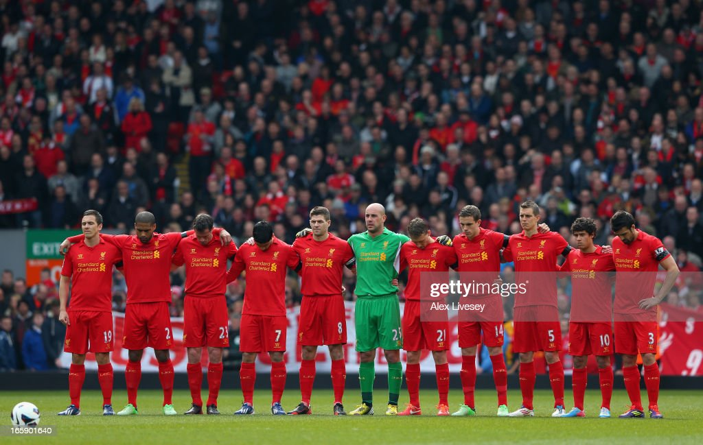 The Liverpool players acknowledge a minutes silence for the victims of the Hillsborough disaster prior to the Barclays Premier League match between Liverpool and West Ham United at Anfield on April 7, 2013 in Liverpool, England.