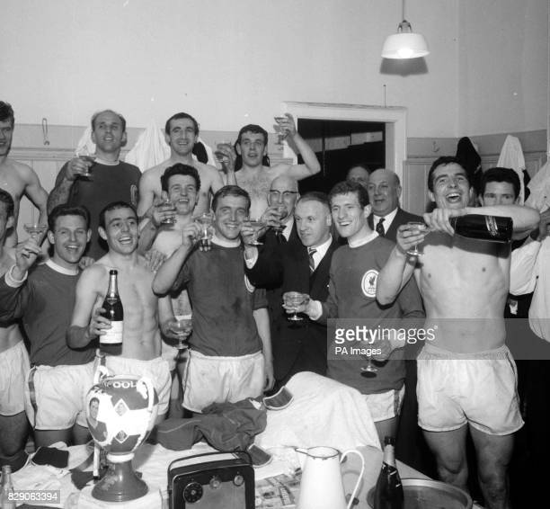The Liverpool players and manager Bill Shankly celebrating with champagne in the dressing room at Anfield after the 50 victory over Arsenal which...