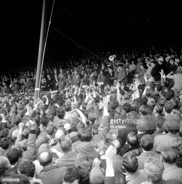 The Liverpool players and manager Bill Shankly line up in the stands at Anfield to receive the crowd's ovation after the 50 victory over Arsenal...