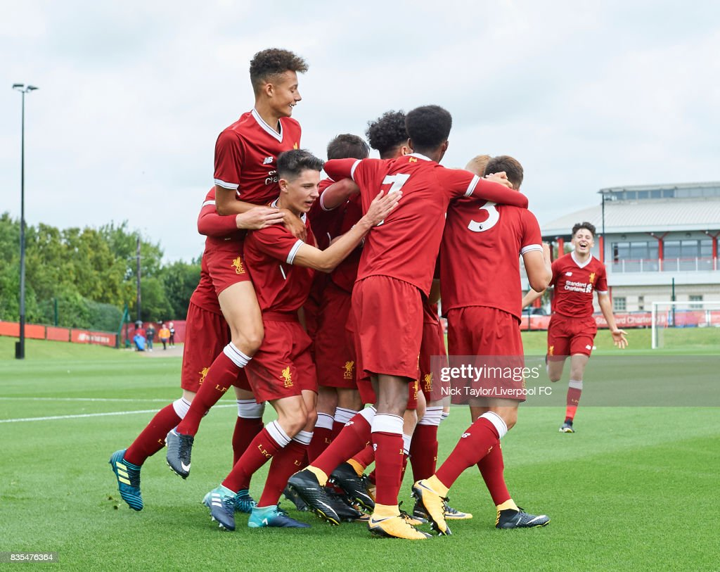 The Liverpool players celebrate Edvard Sandvik Tagseth's goal together during the Liverpool v Blackburn Rovers U18 Premier League game at The Kirkby Academy on August 19, 2017 in Liverpool, England.