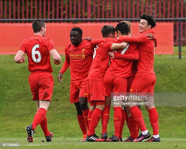 The Liverpool players celebrate Rhian Brewster's opening goal Liam Coyle Bobby Adekanye Adam Lewis Yan Dhanda Glen McAuley and Curtis Jones during...