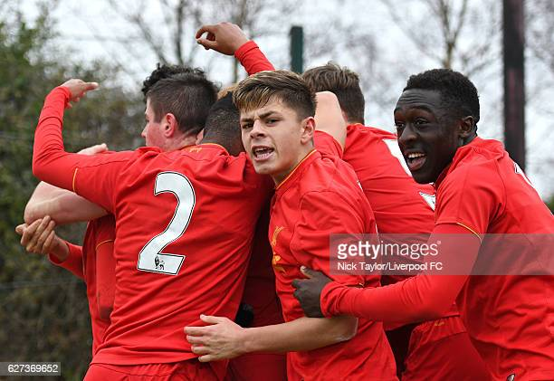 The Liverpool players celebrate Rhian Brewster's second goal Liam Coyle Deigo Lattie Adam Lewis and Bobby Adekanye during the Liverpool v...