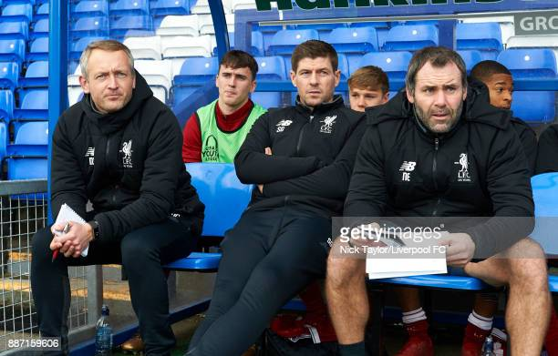 The Liverpool staff U23 manager Neil Critchley U18 manager Steven Gerrard and goalkeeping coach Neil Edwards during the UEFA Champions League group E...