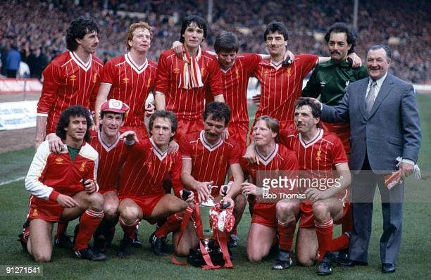 The Liverpool team celebrate with the trophy after defeating Manchester United in the League Cup Final held at Wembley Stadium on the 26th March 1983...