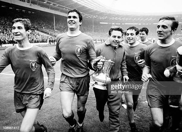 The Liverpool team including left to right Geoff Strong Ron Yeats Gordon Milne Ian Callaghan Chris Lawler and Peter Thompson parade the trophy on the...