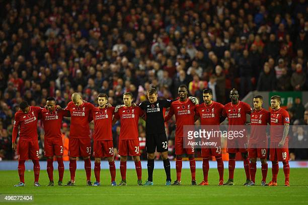 The Liverpool team line up to observe a one minute silence on Rememberance Sunday prior to the Barclays Premier League match between Liverpool and...