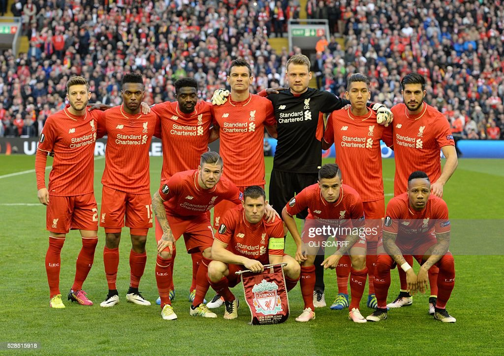 The Liverpool team pose for a team picture ahead of the start of the UEFA Europa League semi-final second leg football match between Liverpool and Villarreal CF at Anfield in Liverpool, northwest England on May 5, 2016. / AFP / OLI