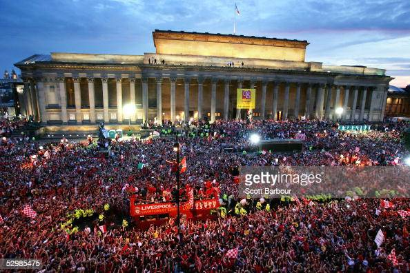 The Liverpool team rides on an open top bus through a mass of fans as they arrive at St George's Hall during the Liverpool Champions League Victory...