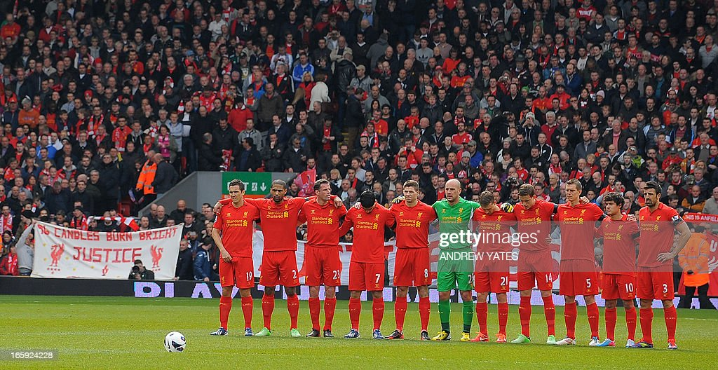 "The Liverpool team stand for a minute's silence in memory of the1989 Hillsborough disaster before the English Premier League football match between Liverpool and West Ham United at Anfield stadium in Liverpool, northwest England, on April 7, 2013. The game finished 0-0. USE. No use with unauthorized audio, video, data, fixture lists, club/league logos or ""live"" services. Online in-match use limited to 45 images, no video emulation. No use in betting, games or single club/league/player publications."
