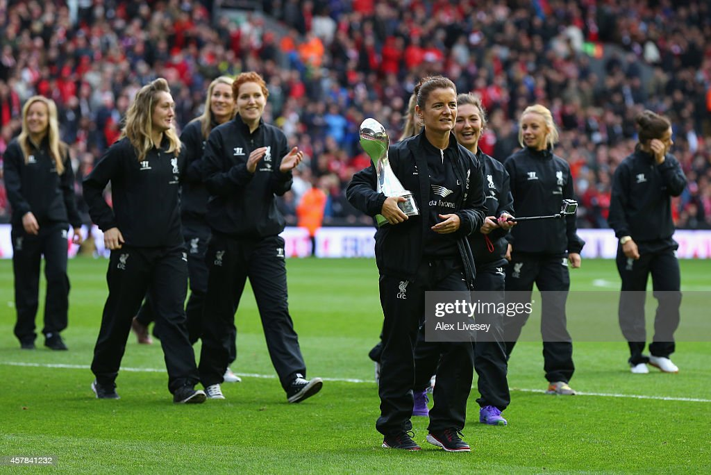 The Liverpool women's football team parade the Women's Super League trophy at half time during the Barclays Premier League match between Liverpool...