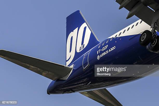 The livery of an aircraft operated by Go Airlines Ltd is seen on the tail fin as the plane prepares to land at Chhatrapati Shivaji International...