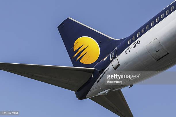 The livery of an aircraft operated by Jet Airways India Ltd is seen on the tail fin as the plane prepares to land at Chhatrapati Shivaji...