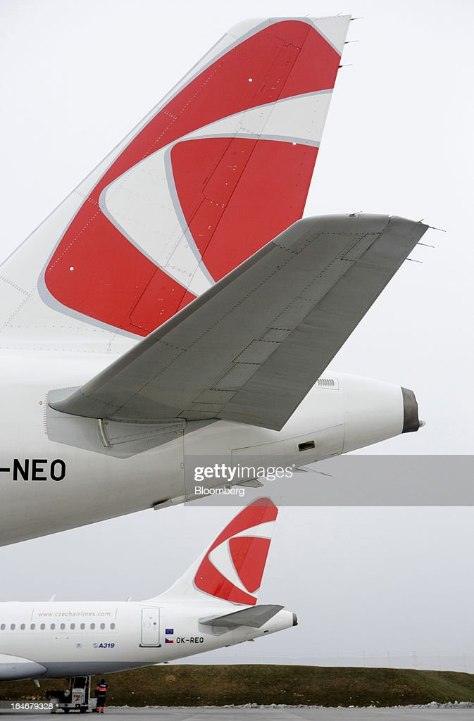 The livery of Ceske Aerolinie AS (CSA) airline is displayed on the tailfins of passenger aircraft at Vaclav Havel airport in Prague, Czech Republic, on Monday, March 25, 2013. Korean Air Lines Co. pledged to hold its stake in Ceske Aerolinie AS for five years, while CSA's majority owner will refrain from making 'significant' changes in its strategy, according to terms of this week's sale. Photographer: Martin Divisek/Bloomberg via Getty Images