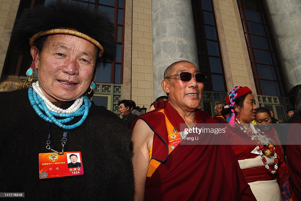 The living Buddha (Center) and ethnic minority delegates of Tibet leave the closing ceremony of the Chinese People's Political Consultative Conference (CPPCC) at the Great Hall of the People on March 13, 2012 in Beijing, China. Known as 'liang hui,' or 'two organizations', it consists of meetings of China's legislature, the National People's Congress (NPC), and its advisory auxiliary, the Chinese People's Political Consultative Conference (CPPCC).