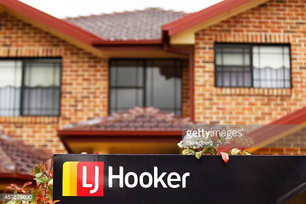 The LJ Hooker Ltd logo is displayed on a sign outside a house in the suburb of Roseville in Sydney Australia on Saturday Oct 18 2014 Sydneys median...