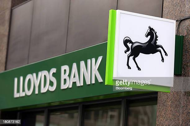 The Lloyds bank logo sits outside a branch operated by the Lloyds Banking Group Plc in London UK on Tuesday Sept 17 2013The UK government made about...