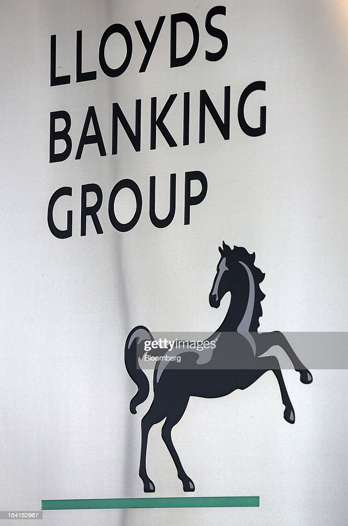 The Lloyds Banking Group Plc logo is displayed outside the bank's headquarters in London, U.K., on Monday, Oct. 15, 2012. U.S. homeowners filed a lawsuit against 12 banks, including Lloyds Banking Group Plc, Barclays Bank Plc, and JPMorgan Chase & Co., claiming that manipulation of the benchmark Libor lending rate made their mortgage repayments more expensive. Photographer: Simon Dawson/Bloomberg via Getty Images