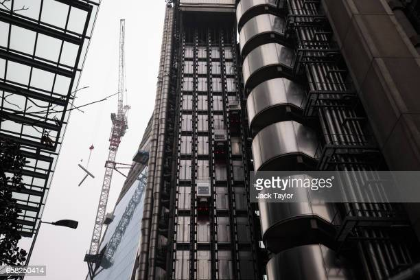 The Lloyd's building home of the world's largest insurance market Lloyd's of London is seen as a crane lifts metal beams on March 27 2017 in London...