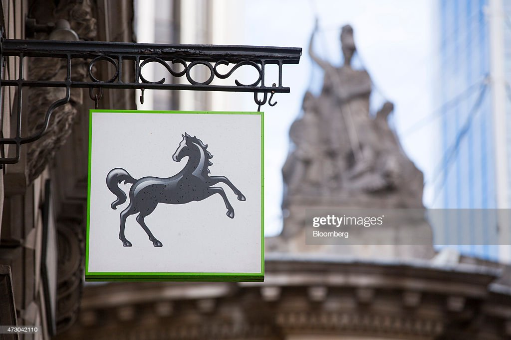 The Lloyds' prancing horse logo sits on a sign as it hangs outside a Lloyds Bank branch a unit of Lloyds Banking Group Plc in London UK on Tuesday...