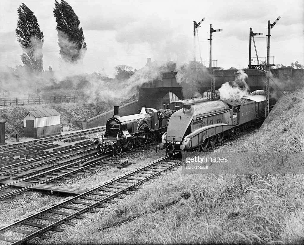 The LNER express passenger train the Flying Scotsman passes an older train at Stevenage in Hertfordshire 30th June 1938