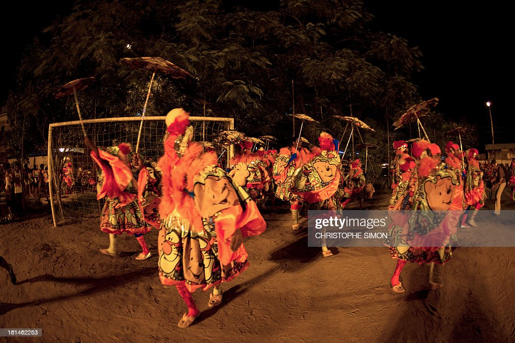 The local 'Indio' carnival group of the Guadalupe neighborhood in northern Rio de Janeiro, Brazil, take part in their 'Bate Bola' traditional parade on February 10, 2013