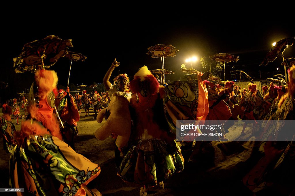 The local 'Indio' carnival group of the Guadalupe neighborhood in northern Rio de Janeiro, Brazil, take part in their 'Bate Bola' traditional parade on February 10, 2013. AFP PHOTO/Christophe Simon
