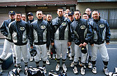 The local Kyoto high school baseball team, get together for a group shot before heading off to the game.