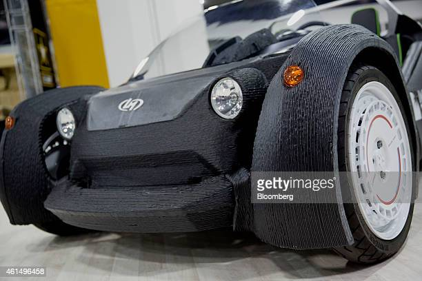 The Local Motors 3Dprinted Strati vehicle sits on display during the 2015 North American International Auto Show in Detroit Michigan US on Tuesday...