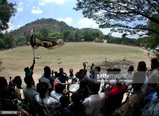The local supporters play music and wave the Sri Lankan National flag as the England cricket team field during the OneDay match at the Welagedara...