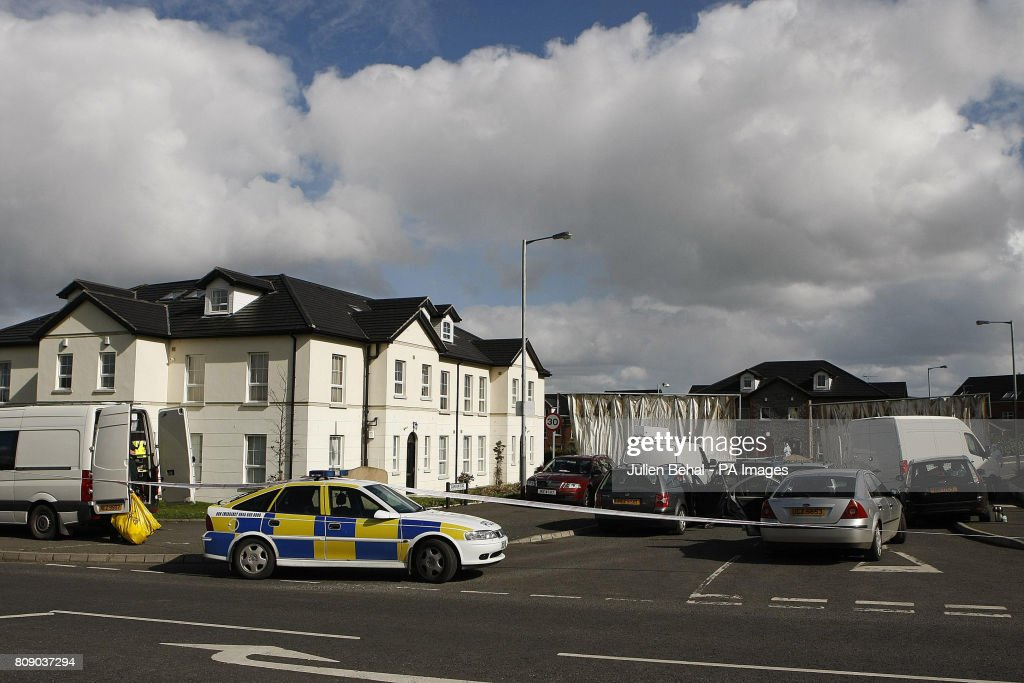 The location in Highfield Close, Omagh, as forensic PSNI officers work at the scene after Catholic police officer Ronan Kerr, 25, was killed yesterday by a booby-trap car bomb in Northern Ireland.