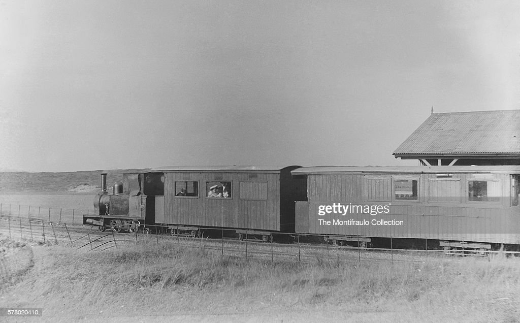 The locomotive Camber leaving Camber Station with several passengers sitting in first class section of the carriage The Rye and Camber Tramway was...