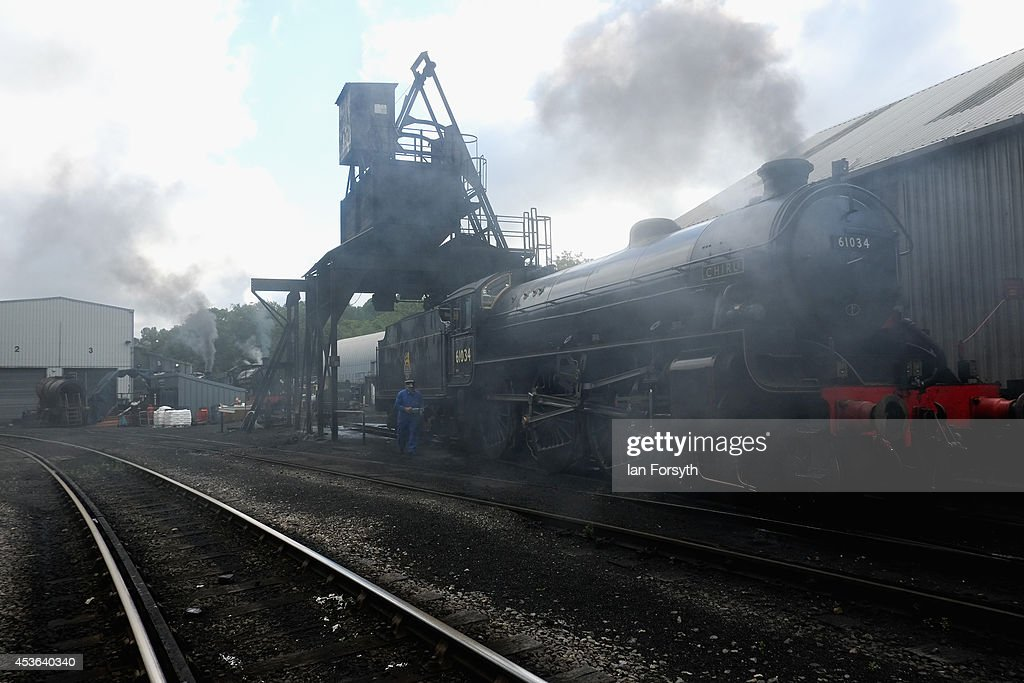 The locomotive 'Chiru' is filled up with coal at Grosmont train engine sheds in preparation for the ceremony to mark a second platform opening at Whitby train station on August 15, 2014 in Whitby, England. The second platform will provide passengers with more options for travel to the Yorkshire seaside town on the North Yorkshire Moors Railway and was the first time in half a century two steam locomotives were side by side at the station.