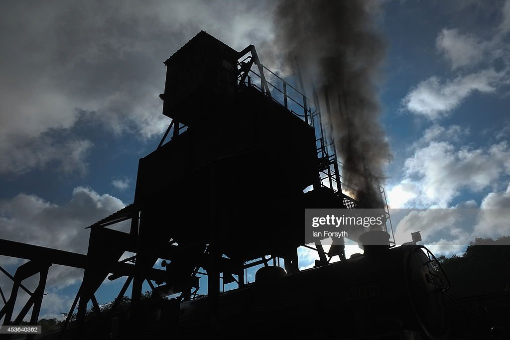 The locomotive 'Chiru' is filled with coal at Grosmont train engine sheds in preparation for the ceremony to mark a second platform opening at Whitby train station on August 15, 2014 in Whitby, England. The second platform will provide passengers with more options for travel to the Yorkshire seaside town on the North Yorkshire Moors Railway and was the first time in half a century two steam locomotives were side by side at the station.