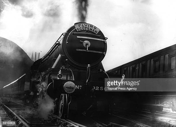 The locomotive engine the Flying Scotsman leaving King's Cross Station London for its 392mile run to Scotland