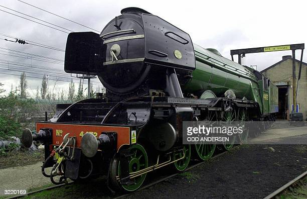 The locomotive 'Flying Scotsman' sits at the Southall railway centre in west London 05 April 2004 The famous steam train will go on display at the...