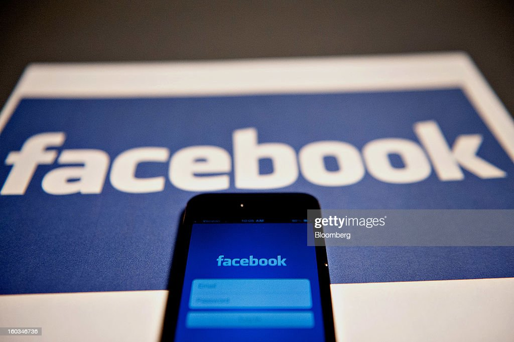 The login page for the Facebook Inc. mobile application is displayed on an Apple Inc. iPhone 5 in Tiskilwa, Illinois, U.S., on Tuesday, Jan. 29, 2013. Facebook Inc. is scheduled to report quarterly earnings on Jan. 30. Photographer: Daniel Acker/Bloomberg via Getty Images