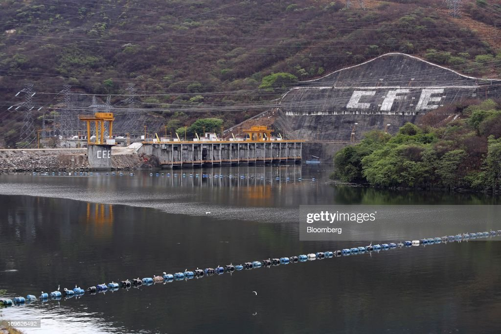 The logo for Comision Federal de Electricidad's (CFE) is painted on a rock formation at the Manuel M. Torres Dam and hydroelectric power station in the state of Chiapas near Chicoasen, Mexico, on Monday, May 27, 2013. CFE, Latin America's biggest utility, is trying to capitalize on investor demand that's made Mexico the world's best-performing government bond market to borrow pesos at record-low interest rates. Photographer: Susana Gonzalez/Bloomberg via Getty Images