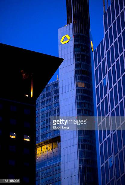 The logo for Commerzbank AG Germany's secondbiggest bank center is seen illuminated at night on top of the company's headquarters in Frankfurt...
