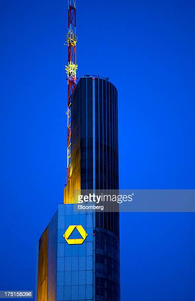The logo for Commerzbank AG Germany's secondbiggest bank is seen illuminated at night on top of the company's headquarters in Frankfurt Germany on...