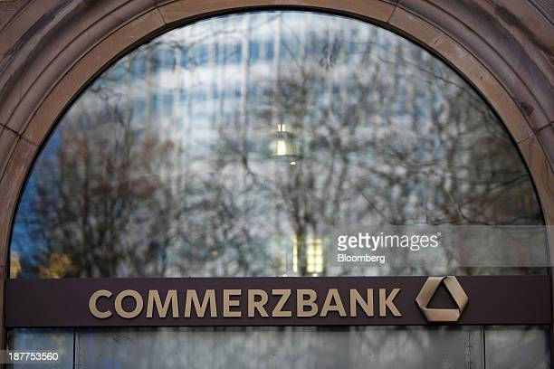 The logo for Commerzbank AG sits on display outside a bank branch in Frankfurt Germany on Monday Nov 11 2013 As the euro area struggles out of the...